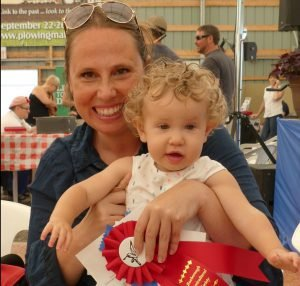 In the 12- to 18-month age category in the baby show at the 2016 Avonmore Fair, Livia Boucher, 1, captured the first prize ribbon for curliest hair in her age category, July 16.