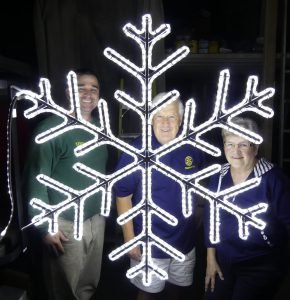 Industrial Stainless co-owner Kent Young (left) poses with the prototype snowflake — 10 of which are set to go up in Chesterville in time for this Christmas — along with Chesterville Rotary Club President Joe Cass and member Betty Vanden Bosch. Zandbergen photo, Nation Valley News