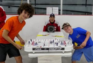 Table hockey Adrien Dellah, 14 (left) takes on 10-year-old Scott LeBlanc in Dairyfest's table-hockey tournament. Zandbergen photo, Nation Valley News