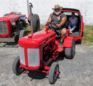 Ralph Winterburn of Winchester Springs Mobile Wash poses with his tractor and unique half-car parade trailer. Zandbergen photo, Nation Valley News