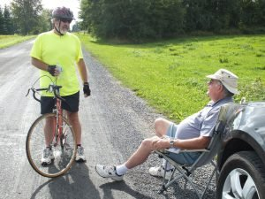 Rotarian David Black, seated, chats with Jim Baker of Winchester at the last checkpoint on the route. Zandbergen photo, Nation Valley News.