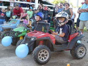 Young entrants get ready to pop balloons in the first-ever Power Wheel derby, Saturday at the Stormont County Fair. Zandbergen photo, Nation Valley News