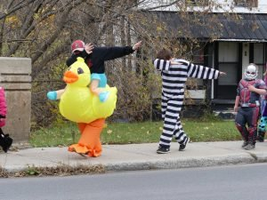 Marty McLeod (left) and Jordan Heuff march up Main Street in Chesterville Public School's Oct. 31. Zandbergen photo, Nation Valley News