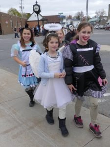 From left, Jayden Cross, Kyra Lascelle and Brianna Miles, among the Chesterville Public School students marching through downtown today (Oct. 31). Zandbergen photo, Nation Valley News