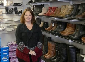 Barkley's Shoes and Accessories proprietor Kristie Billings, inside her new address at 502 Main Street, Winchester. In addition to women's footwear and accessories and (soon) work boots for both genders, the retail establishment hosts the Storm Internet WiFi equipment serving neighbouring Sweet Corner Park. Zandbergen photo, Nation Valley News