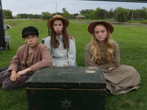 From left, William O'Shea, 12, Eleanor O'Shea, 10 and Mia Grant, 12, all of Cornwall, are the great grandchildren of the late Edwin Matthew Baker, a British Home Child who arrived in Canada in the early 1900s. The trio pose with the original trunk that accompanied Baker on his trans-Atlantic journey at the age of 14. Zandbergen photo, Nation Valley News