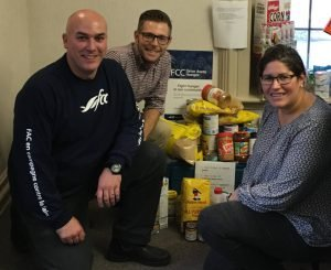 In addition to North Dundas District High School and St. Mary's School in Chesterville, the crew from Farm Credit Canada also stopped in at local businesses on the second day of their annual 'Drive Away Hunger' tractor tour. Shown here Oct. 13 at Collins Barrow in Winchester, where the staff donated 355 lbs of food and $500 cash to the Dundas County Food Bank. At left is FCC's Marc Beaudry along with Benjamin Mann and Amy Sanders from Collins Barrow. Dundas County Food Bank courtesy photo