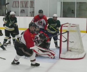 The Eagles buzz the North Dundas net during the first period, Oct. 15. Zandbergen photo, Nation Valley News