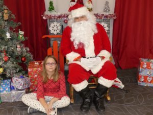 Chloe St. Pierre helped Santa at the Morewood Community Centre, Nov. 19. Zandbergen photo, Nation Valley News