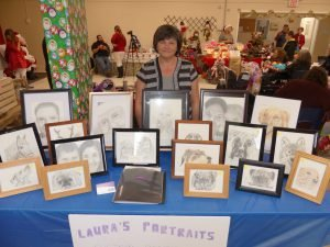 Portrait artist Laura Mayer of Avonmore displayed her talent in Morewood. Zandbergen photo, Nation Valley News