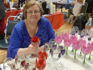 Diane Blais, co-organizer of the annual Crysler Christmas Craft Sale, with her painted wine glasses. Zandbergen photo, Nation Valley News