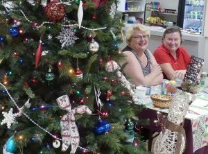 At the registration desk, by the Christmas tree. Zandbergen photo, Nation Valley News