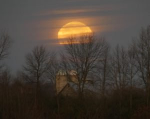 The 'supermoon' sets this morning (Nov. 14) as seen from County Rd. 7 outside Dunbar. Zandbergen photo, Nation Valley News