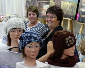 Lyne Lavigne (right) of Limoges showed off her handmade beanies and headscarves at the show. Zandbergen photo, Nation Valley News