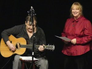 Gordon Wall of South Mountain and Ann Brady of Winchester sing a duet at the North Dundas Mayor's All Stars Christmas Benefit Show. Zandbergen photo, Nation Valley News