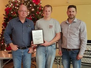 Tom (left) and Doug MacGregor receive the DSCIA's Innovative Farmer of the Year Award for 2016 from Mike Roosendaal (right). Courtesy photo by Elaine Duke