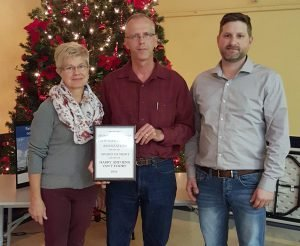 """Harry (centre) and Iena Van't Foort — the """"H and I"""" in H & I Country Supply, winner of this year's"""