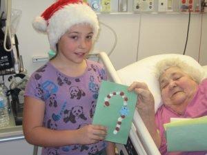 Morrisburg Public School student Jaden Casselman presents a card to WDMH patient Sadie Levesque. Courtesy photo