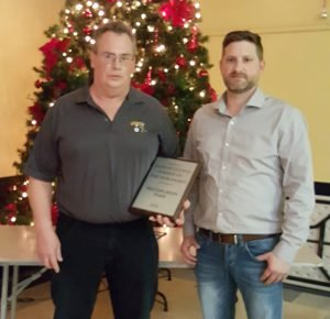Westergreen Farm's John Westervelt receives the DSCIA's 2016 Farmer of the Year Award, on behalf of the Brinston-area operation, from Mike Roosendaal. Courtesy photo by Elaine Duke