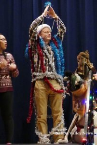 Scott Reaney was one of three teachers decorated on stage like a Christmas tree. Zandbergen photo, Nation Valley News