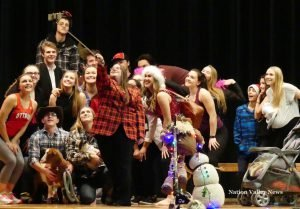 Christmas concert performers made a show of taking a group selfie. Zandbergen photo, Nation Valley News