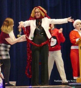 Drama teacher Kathi Wilson accepts the Yuletide treatment on her person. Zandbergen photo, Nation Valley News