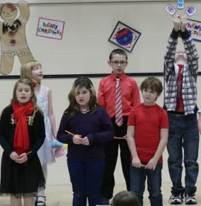 From left, Annika Michaud, Abbigail Whiteside, Bekah Berardini, Jack Chenier, Evan Richardson and Heatley Brown perform as part of the Grade 3-4 class, Dec. 15 at North Stormont Public School's annual Christmas concert. Zandbergen photo, Nation Valley News