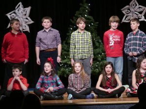 Singing Grade 5 students (front, from left) Ryan Mellon, Maïka Tremblay, Breanna Schellenberg, Nadya Levac and Drew Dingemans and (back, from left) Connor Armstrong, Bobby Robinson, Matthew Lorange, Logan Herfkens and Cohen Bourbonnais. Zandbergen photo, Nation Valley News