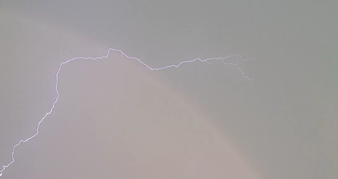Rainbow intersected by lightning above Dundas County   Nation Valley